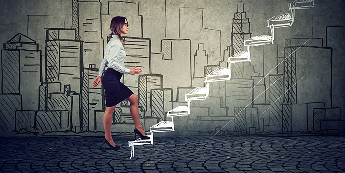 Business Woman Climbing Steps in Career