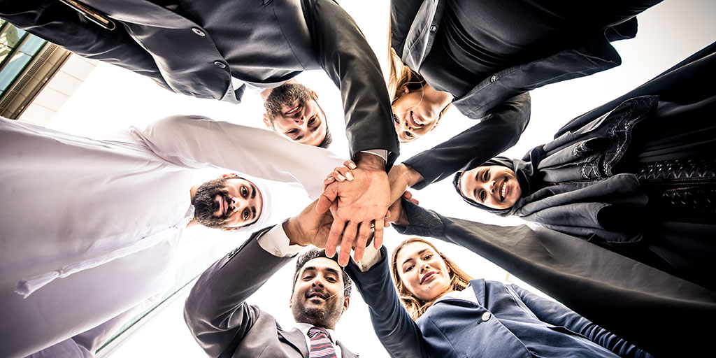 Sales Team Putting Hands Together