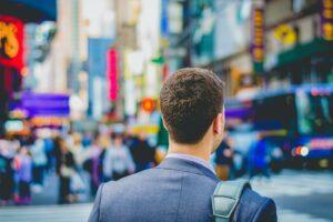 Sales leader walking through a crowded street